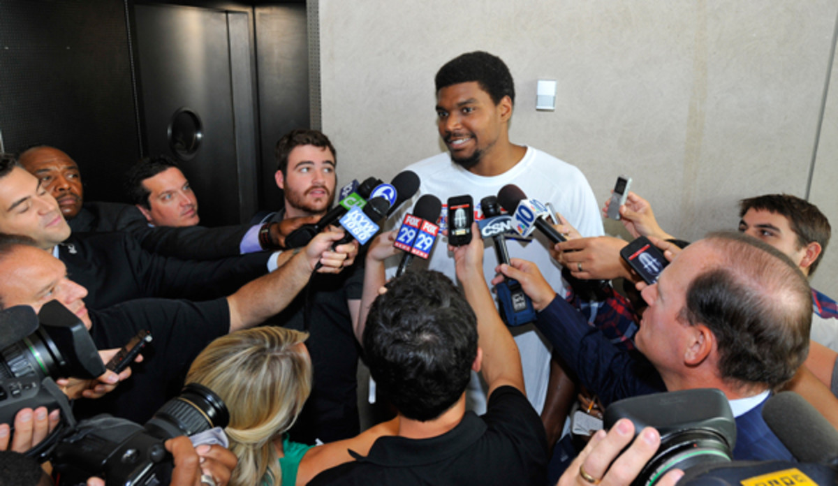 Andrew Bynum (center) met the Philadelphia media last summer but never suited up for the 76ers. (David Dow/Getty Images)