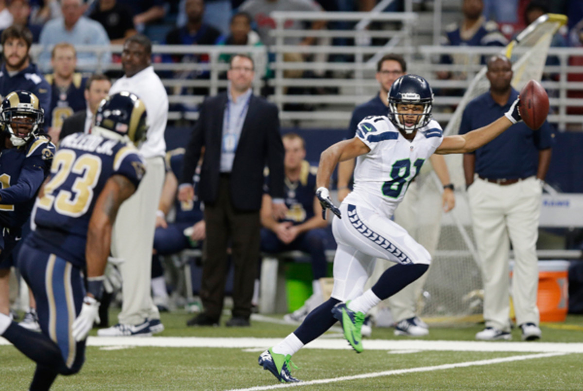 In a game that was ugly from start to finish, even Golden Tate's 80-yard touchdown had room for improvement. (Michael Conroy/AP)