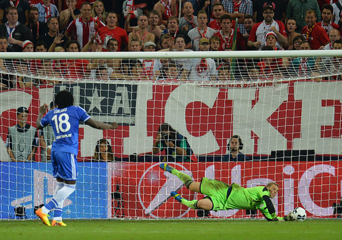 Bayern's Manuel Neuer (right) saved Romelu Lukaku's penalty to lift the German side to victory.