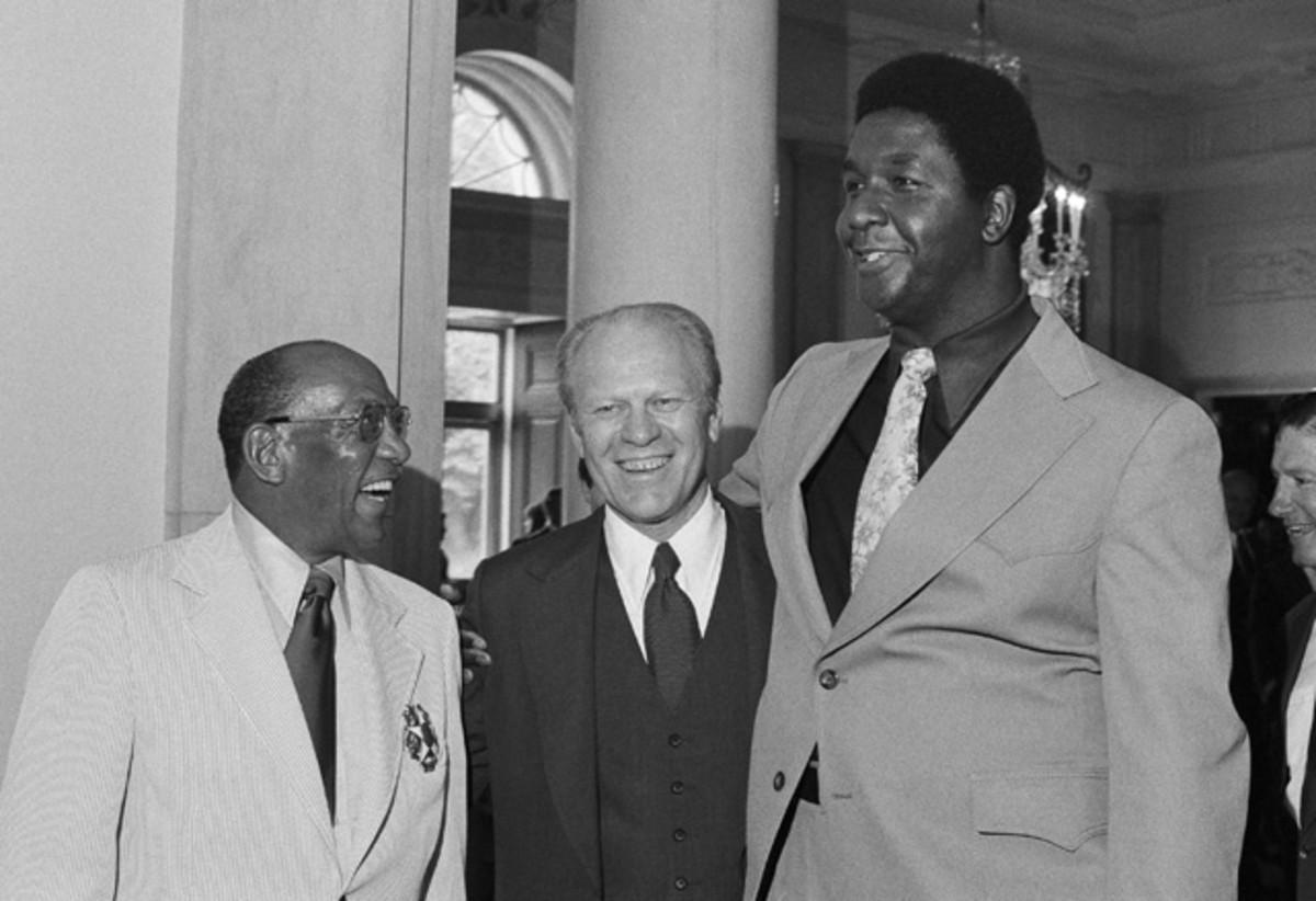 Jesse Owens and John Thompson