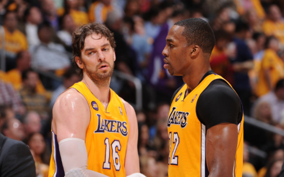 Pau Gasol's future with the Lakers is closely intertwined with free agent-to-be Dwight Howard. (Andrew D. Bernstein/Getty Images)
