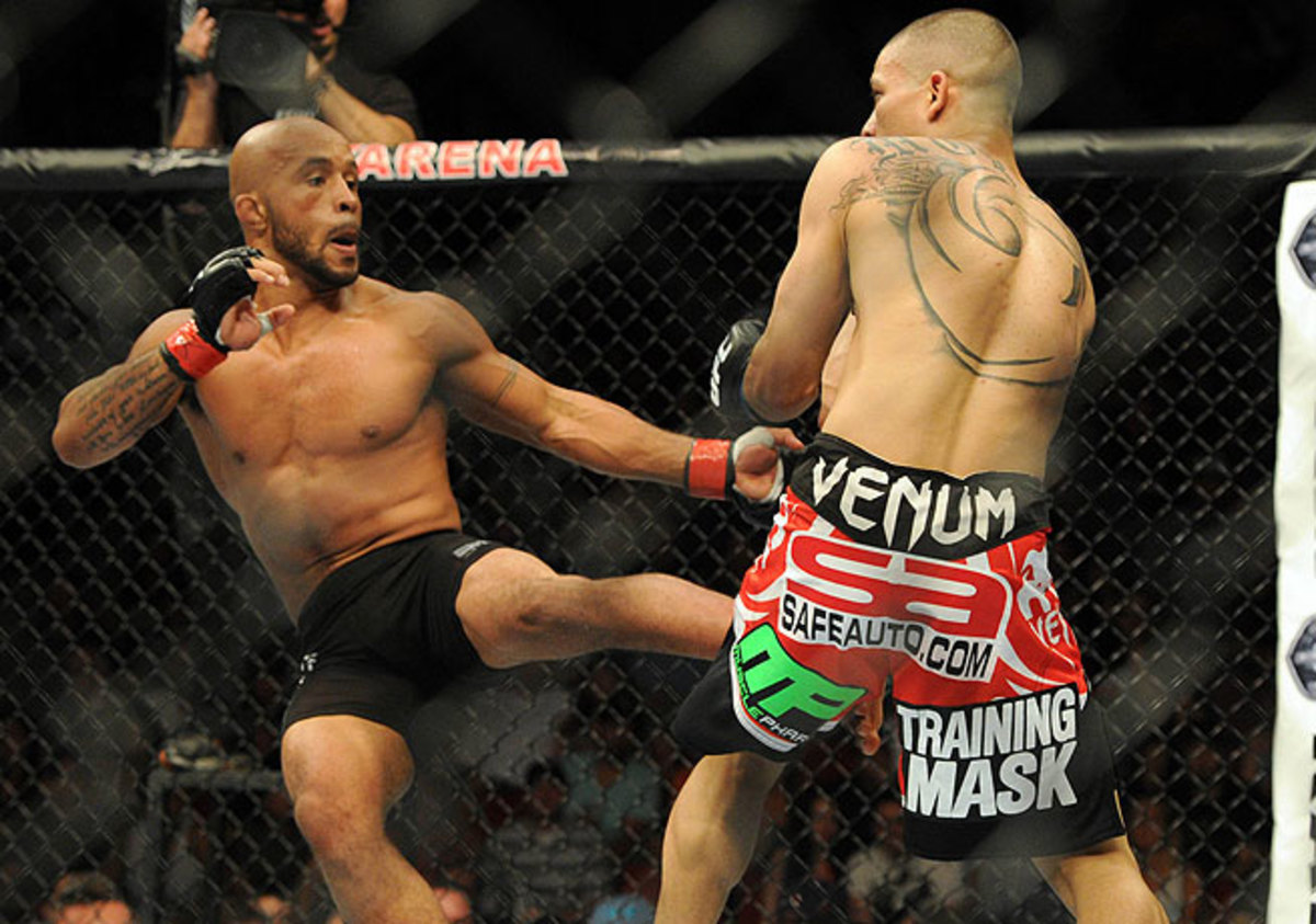 Demetrious Johnson (left) defended his flyweight title for the second time by defeating John Moraga.
