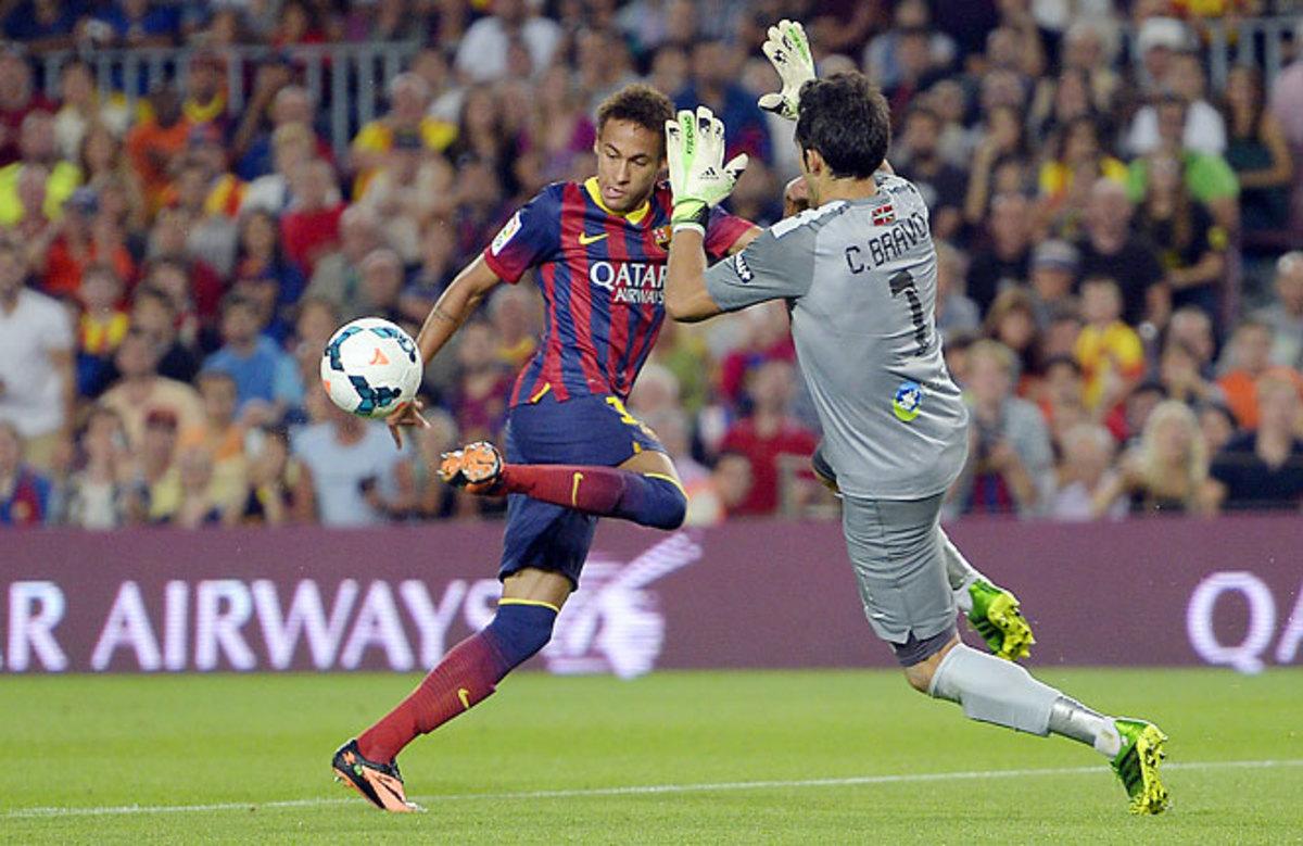 Neymar scored his first league goal of the season as Barcelona trounced Real Sociedad.