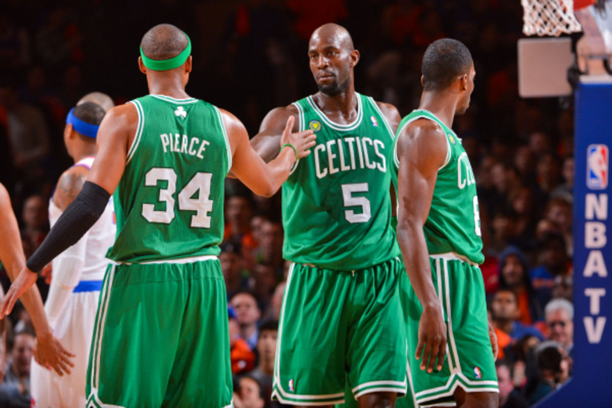 Paul Pierce and Kevin Garnett in Round 1 of the NBA playoffs against the Knicks. The Celtics are reportedly discussing trading the two future Hall of Famers to the Nets. (Jesse D. Garrabrant/Getty Images)