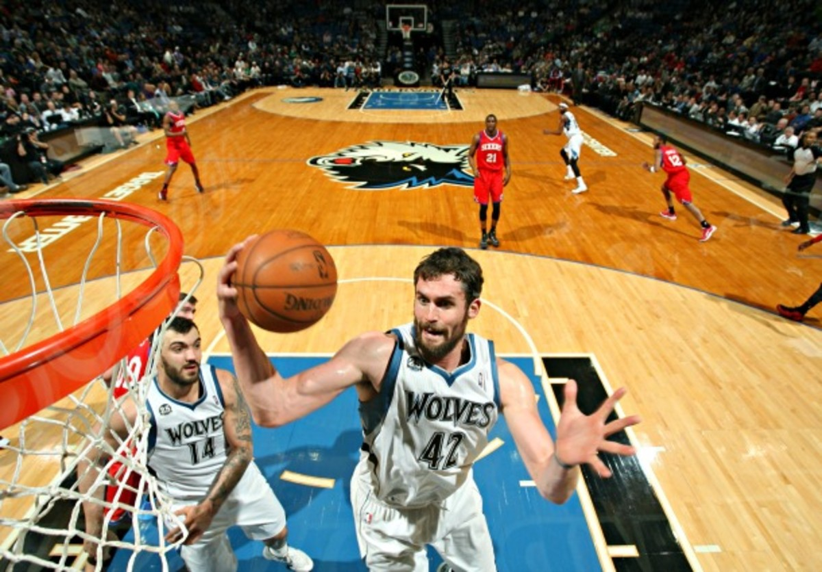 Kevin Love has pulled in the rebound, and Corey Brewer has darted out into the open court. All that's left is to connect the dots. (David Sherman/NBAE via Getty Images)