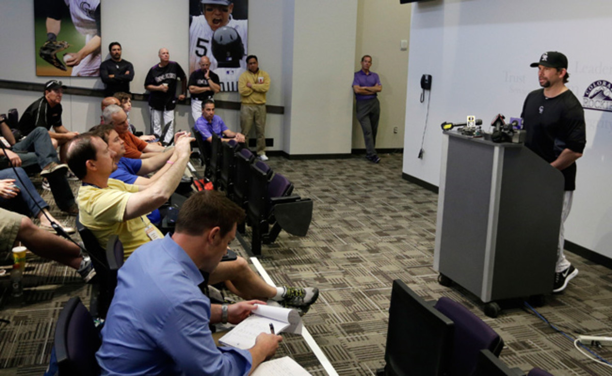 Manager Walt Weiss and coaches watched as Todd Helton fielded questions for nearly 10 minutes.