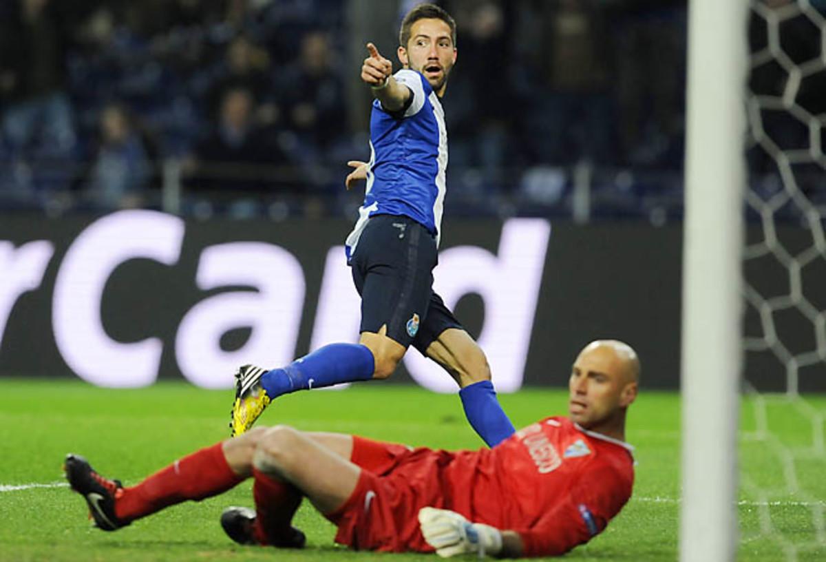FC Porto's Joao Moutinho celebrates after scoring past Malaga goalkeeper Willy Caballero.