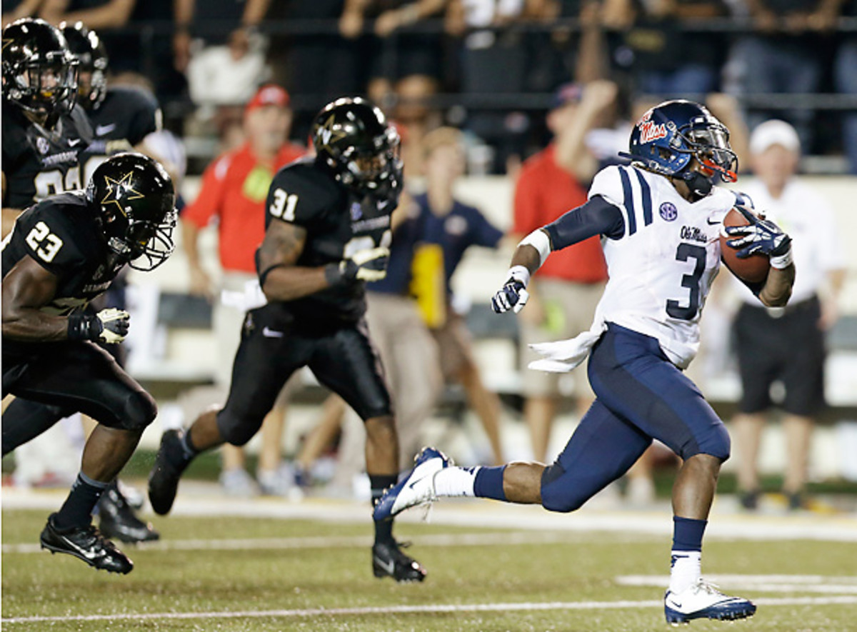 Mississippi running back Jeff Scott saved the Rebels with this 75-yard TD run. (Mark Humphrey/AP)