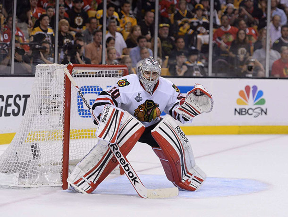 Chicago's Corey Crawford earned top marks for standing tall against the Bruins in the Cup-clinching Game 6 win.