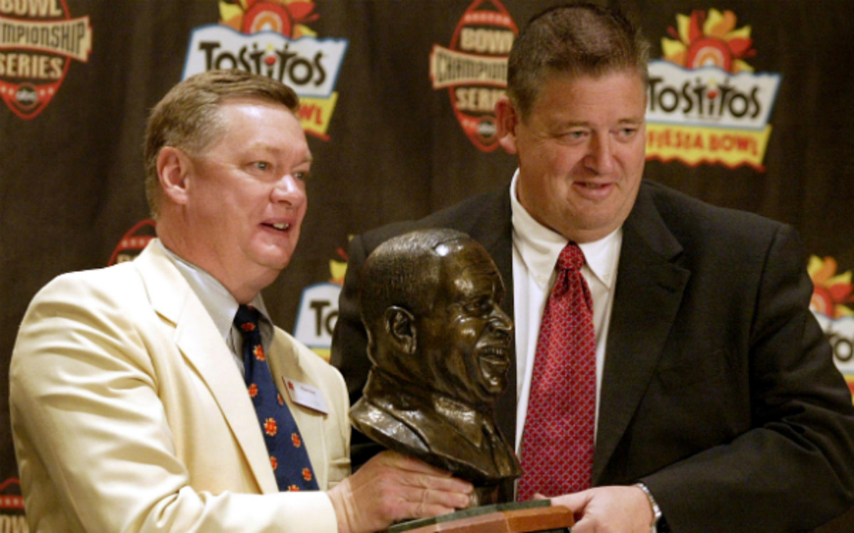 Former Fiesta Bowl CEO (left) could face prison time for his role in an illegal campaign-finance scheme. (AP photo)