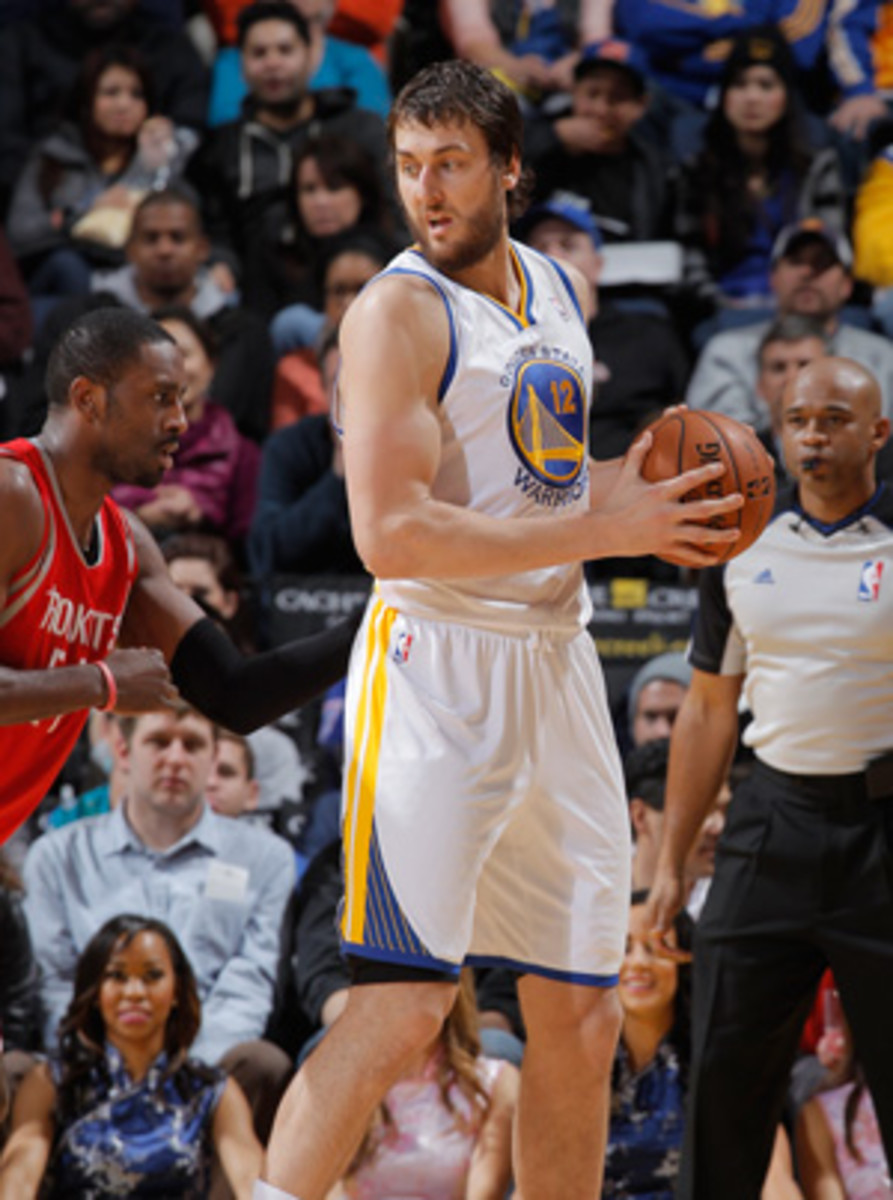 Warriors center Andrew Bogut will be sidelined with a back injury. (Rocky Widner/Getty Images)