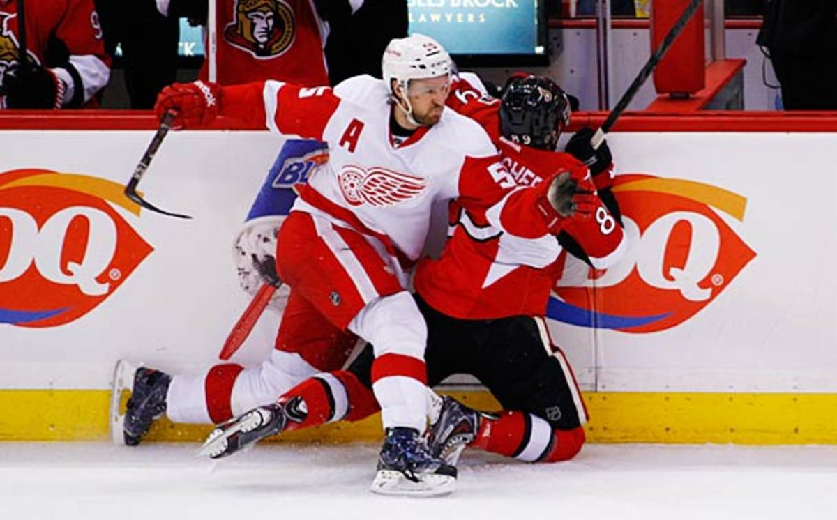 Niklas Kronwall of the Detroit Red Wings Kronwalls Cory Conacher of the Ottawa Senators.