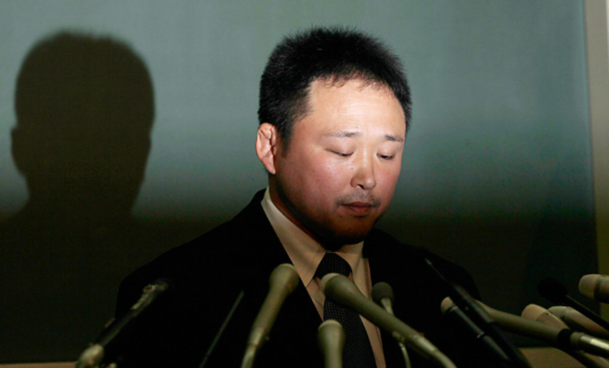 Ryuji Sonoda answers questions during a January press conference. Sonoda was accused of harassing members of the Japanese women's judo team and subsequently resigned.