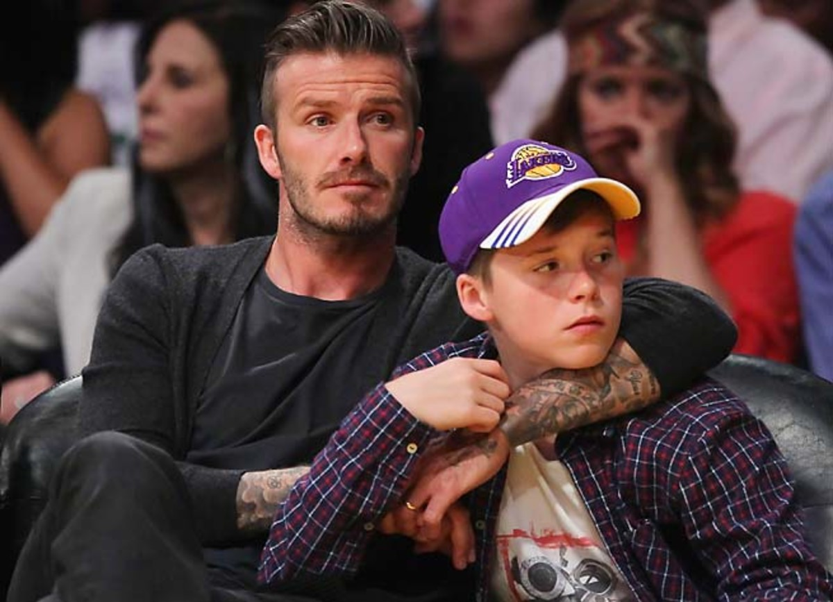 David Beckham and son Brooklyn take in a Lakers game at Staples Center.