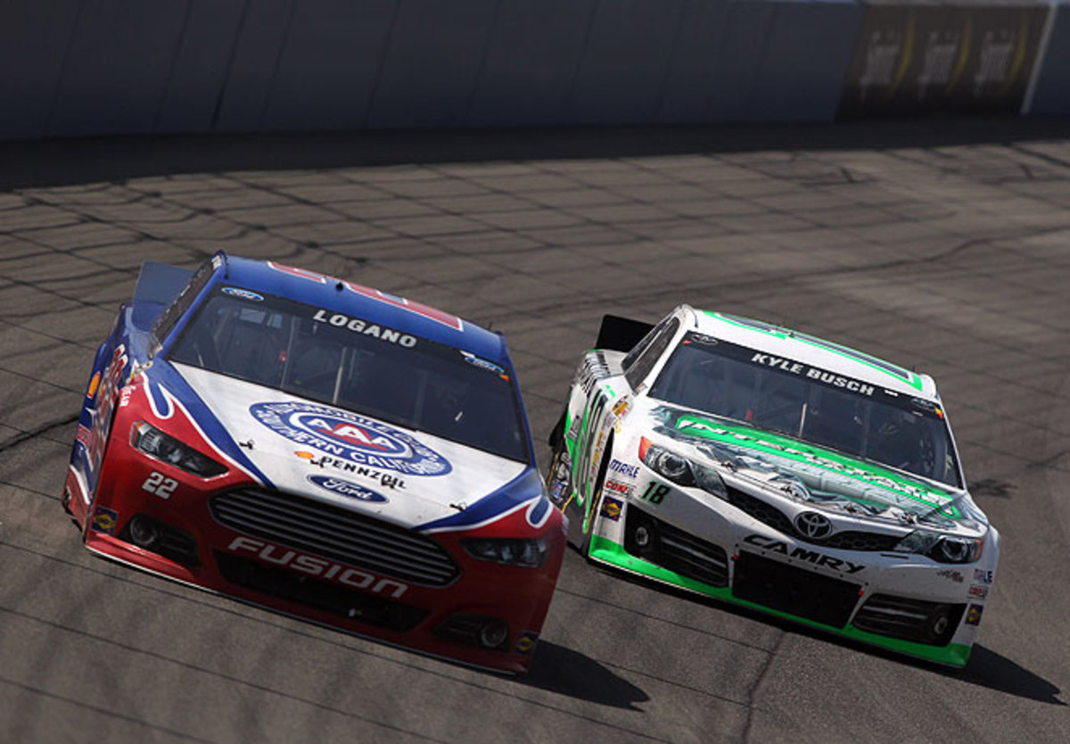 Kyle Busch (right) got his first win at the Auto Club Speedway after holding off Joey Logan and others.