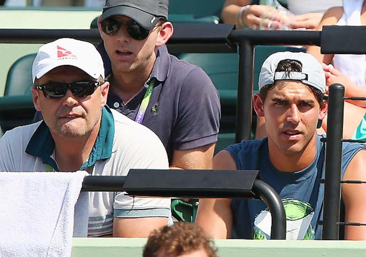 John Tomic (left) is no longer coaching son Bernard.