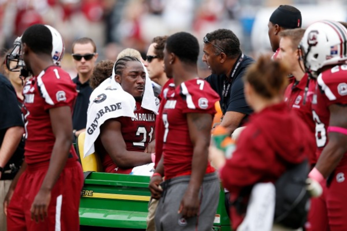 Marcus Lattimore won't play this season, per a report, as he continues to recover from a knee injury he suffered in 2012. (Joe Robbins/Getty Images)