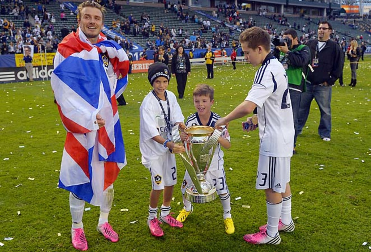 David Beckham celebrates an MLS Cup win with sons Romeo, second from left, Cruz, second from right, and Brooklyn.