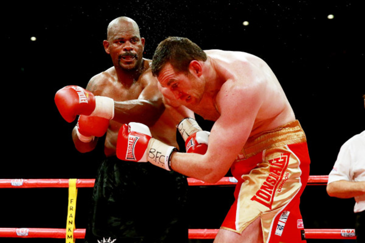 Tony Thompson (left) recorded a TKO victory over David Price on July 6 in Liverpool. (Scott Heavey/Getty Images)