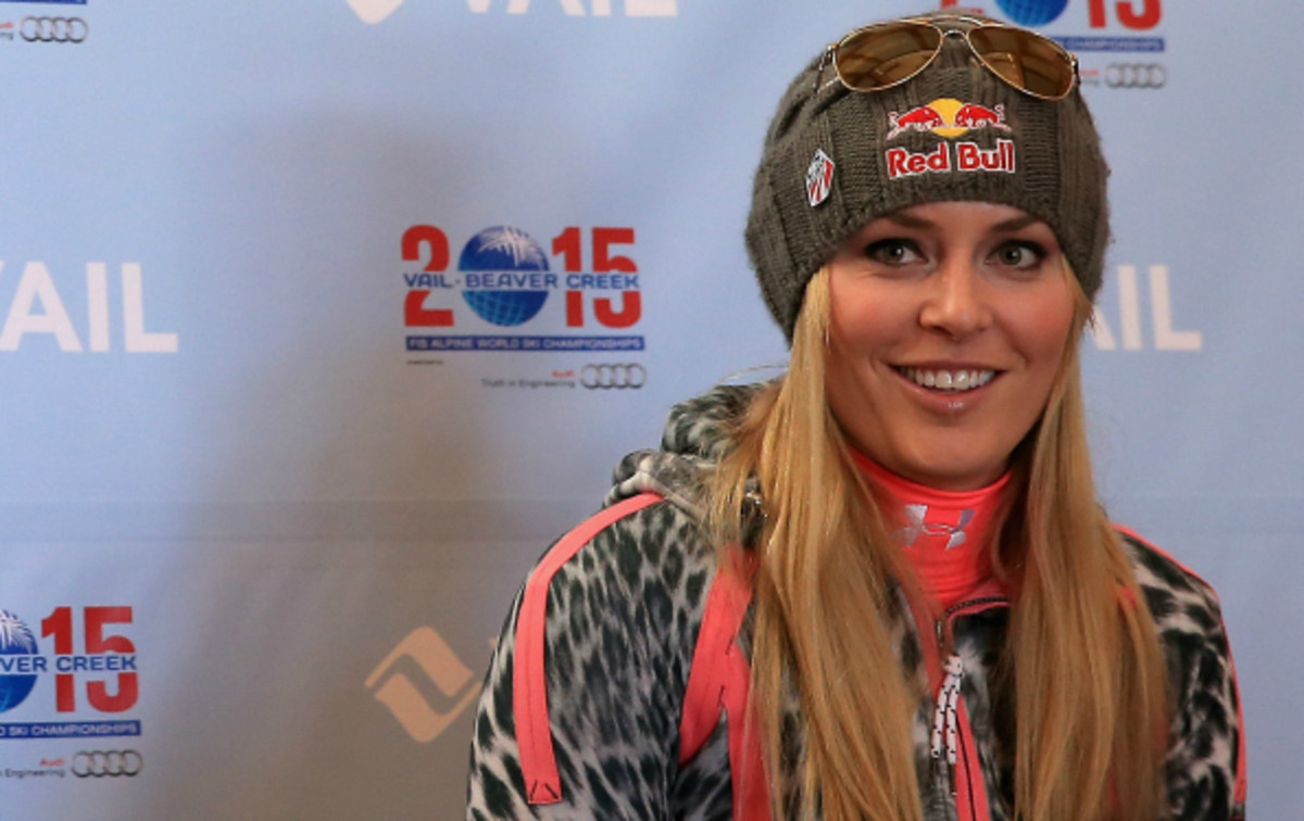 Lindsey Vonn has an Olympic Downhill gold medal to go with her 4 overall World Cup championships. (Doug Pensinger/Getty Images)