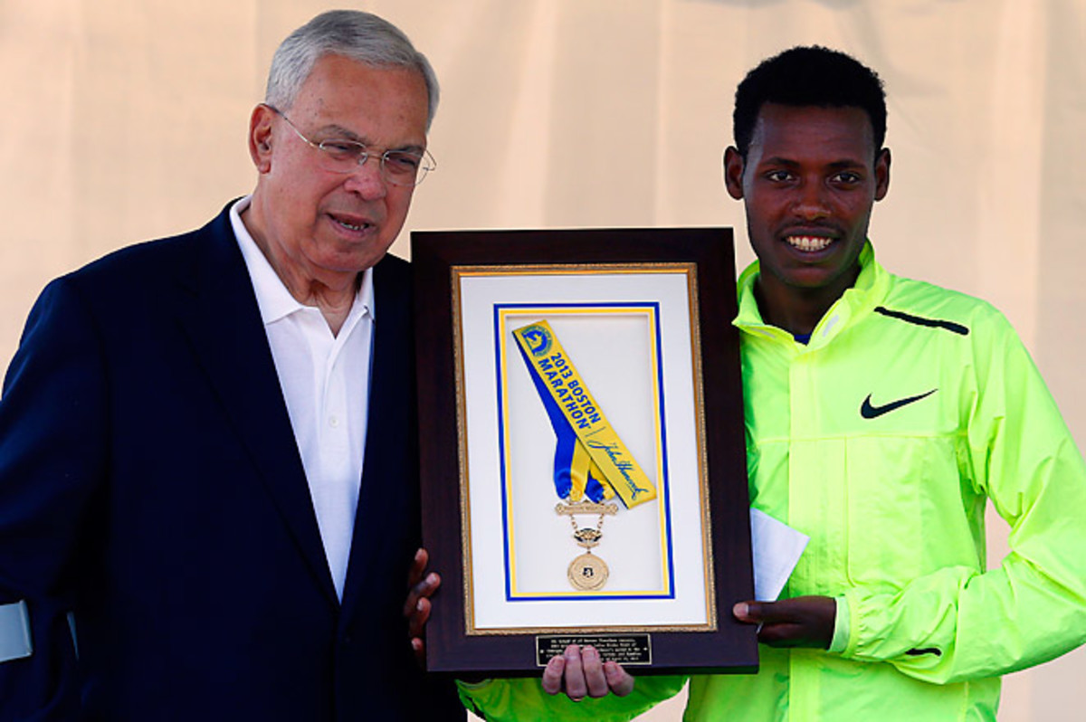 Lelisa Desisa of Ethiopia returned his medal to Mayor Thomas Menino to honor the city of Boston.