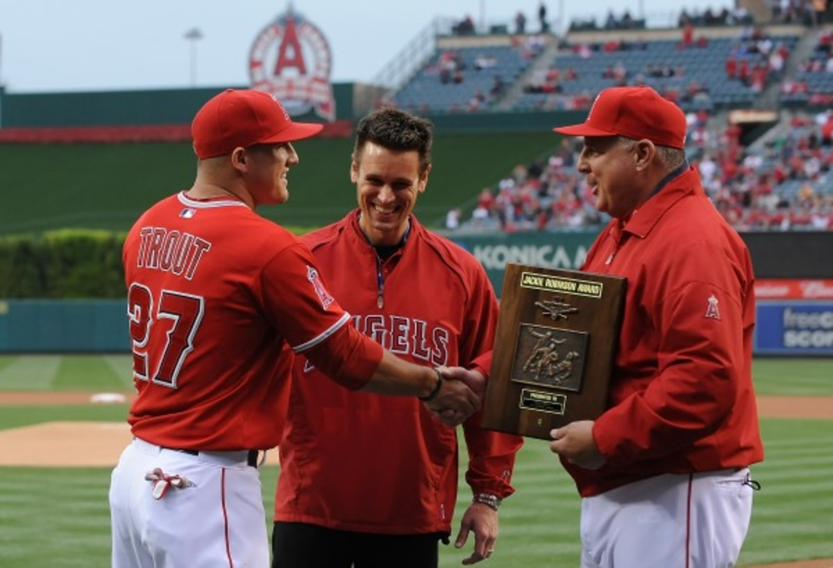 Even with Trout, Jerry Dipoto, middle, and Mike Scioscia, right, can't build a winner in Los Angeles. (Lisa Blumenfeld/Getty Images)