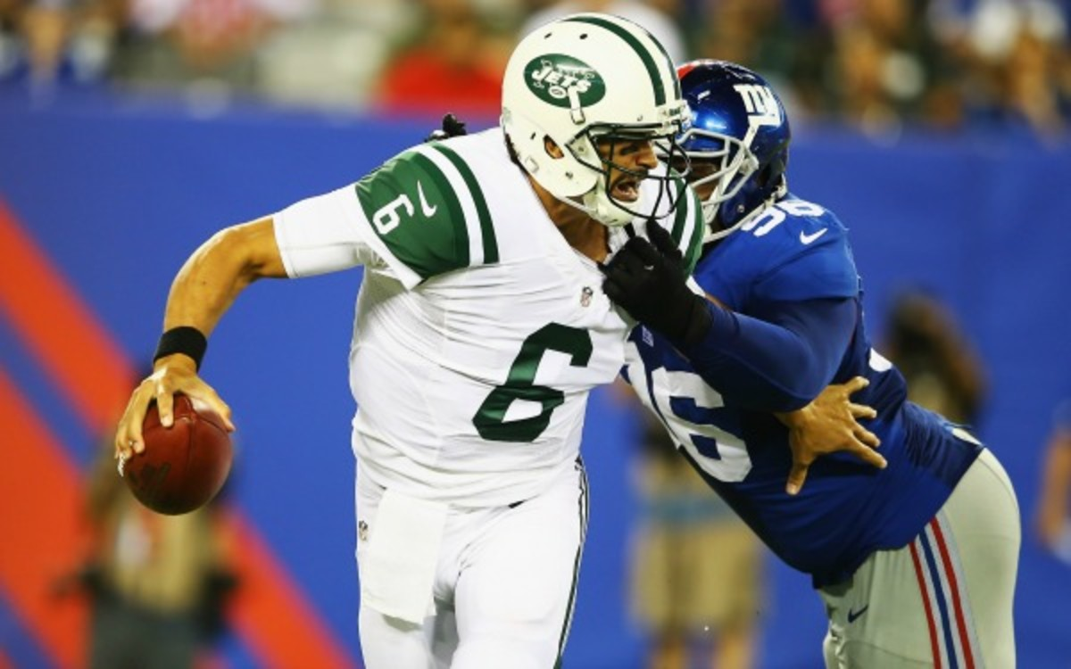 Mark Sanchez left the game early with a shoulder injury after getting hit by Marvin Austin. (Al Bello/Getty Images)