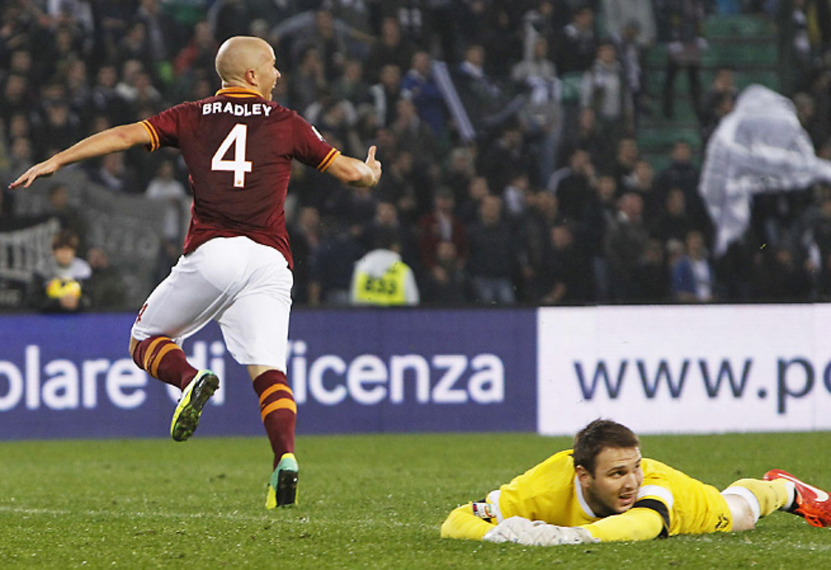 Michael Bradley netted the crucial winner to lift 10-man Roma over Udinese.