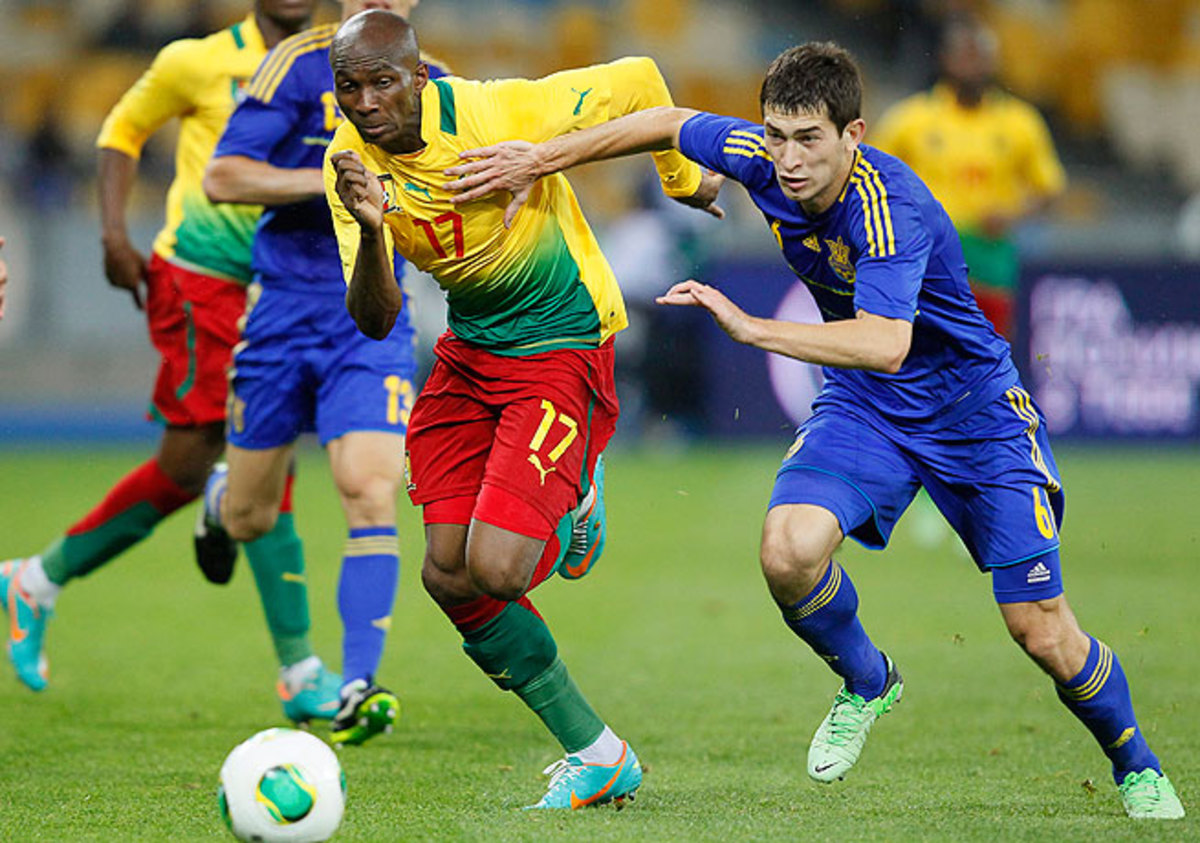 Stephane Mbia (left) and Cameroon faced possible disqualification from the 2014 World Cup in Brazil.