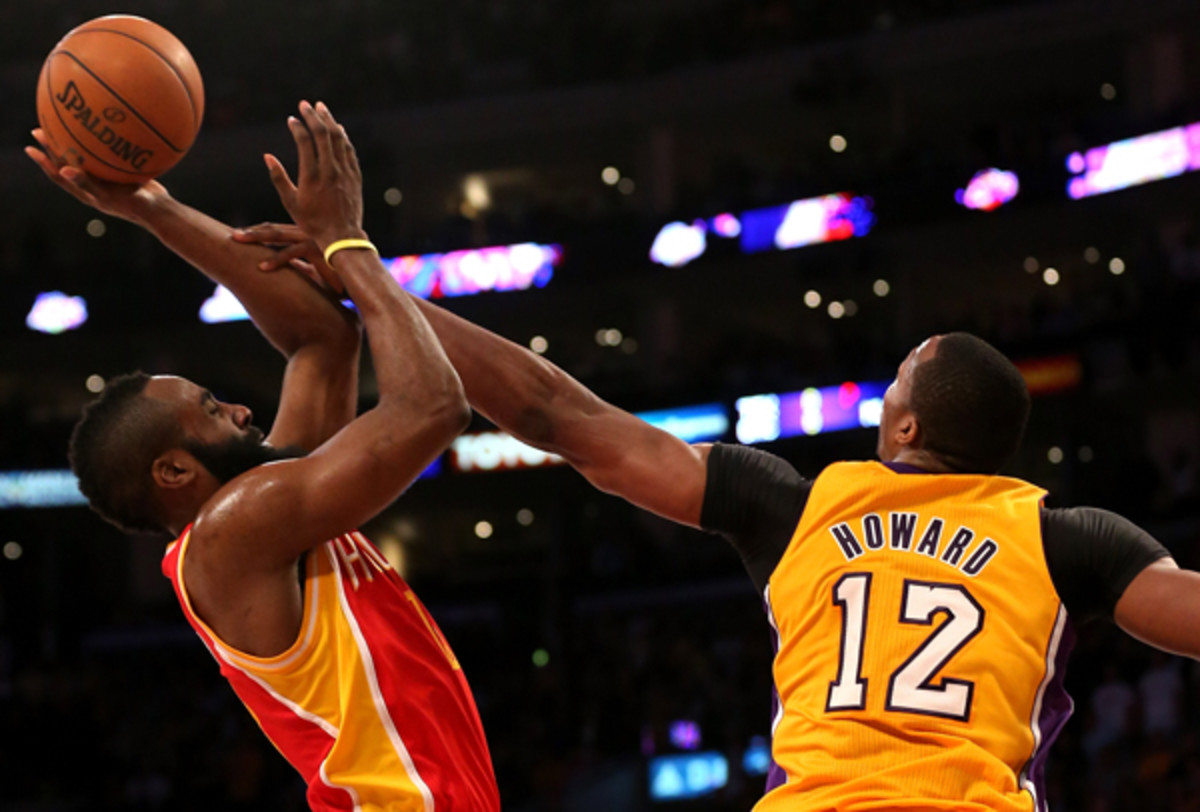 Would Dwight Howard (right) team up with James Harden in Houston? (Stephen Dunn/Getty Images)