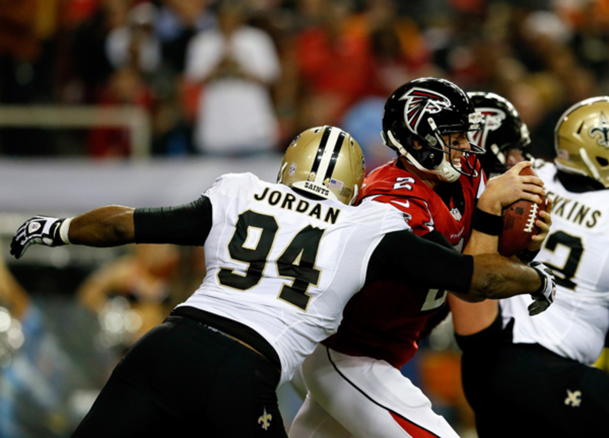Cameron Jordan and the Saints' defense made life rough for Matt Ryan all night long. (Kevin C. Cox/Getty Images)