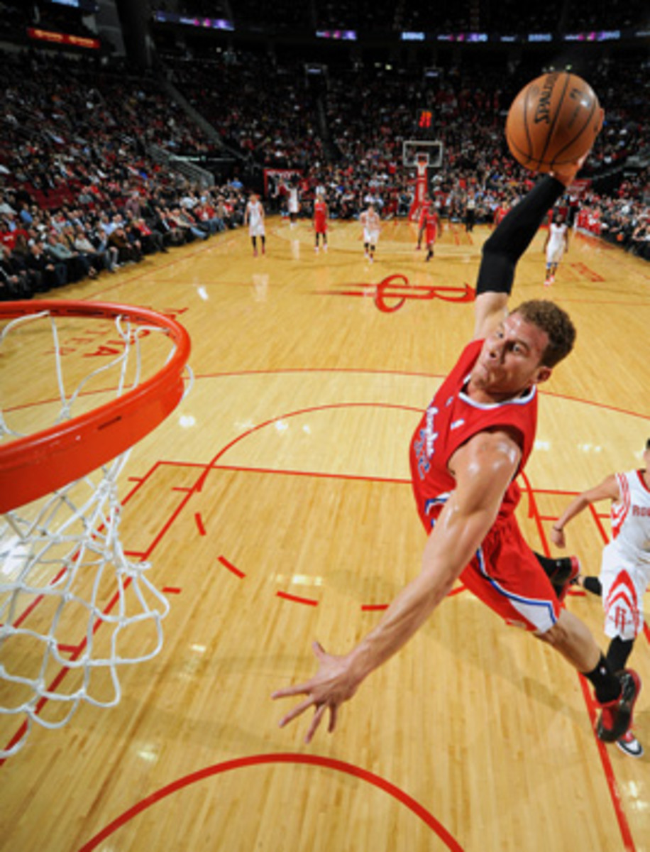 Clippers forward Blake Griffin takes off against the Rockets. (Bill Baptist/Getty Images)