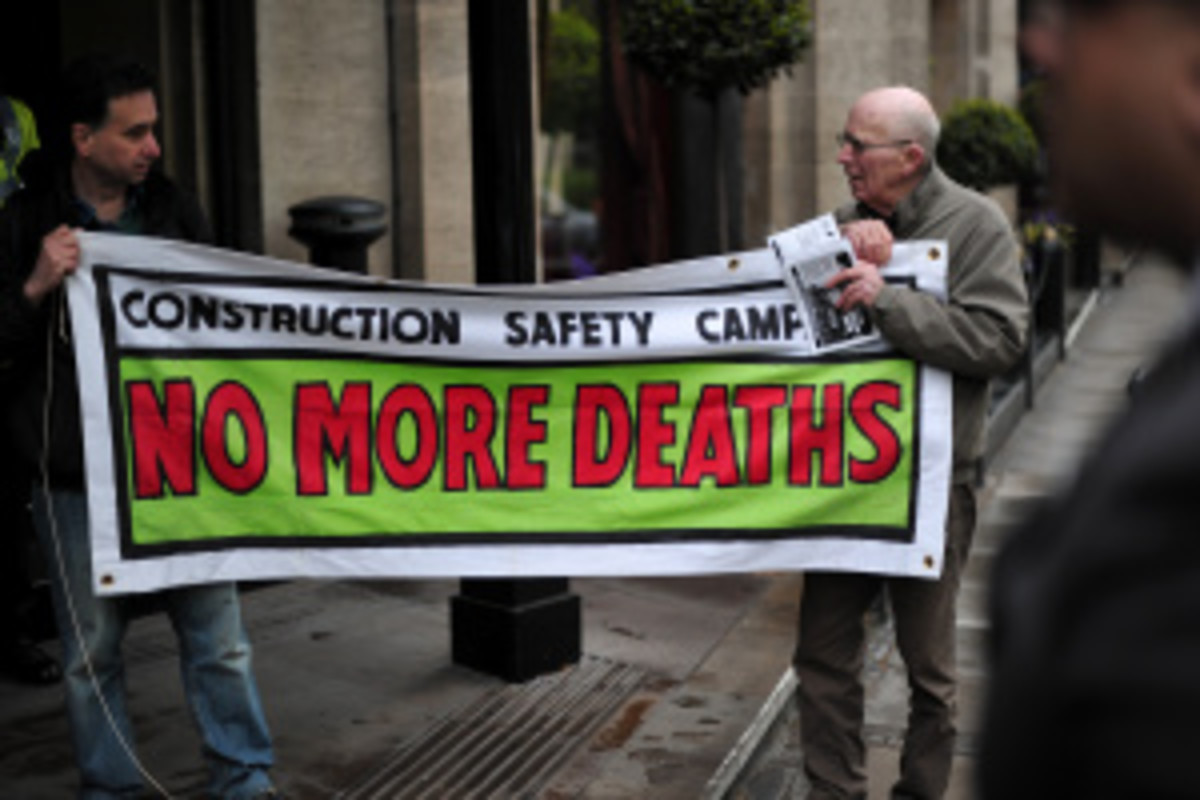 Protesters demonstrate outside a UEFA Congress in central London earlier this year amid reports of thousands of migrant workers expected to die while working on construction in Qatar for the 2022 World Cup.  (Carl Court/Getty Images)