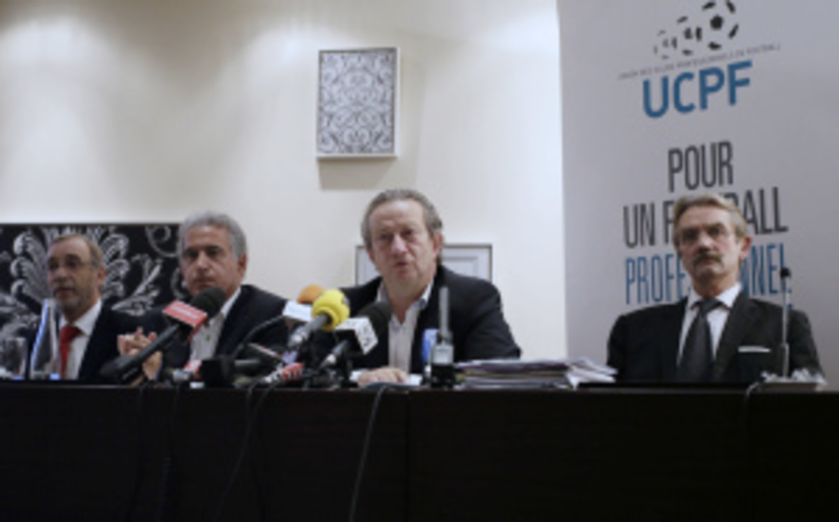 Jean-Pierre Louvel (center), president of the French professional clubs union, held a press conference on Thursday to announce that its clubs will sit out games over the last weekend of November to protest a new government tax. (Kenzo Tribouillard/Getty Images)