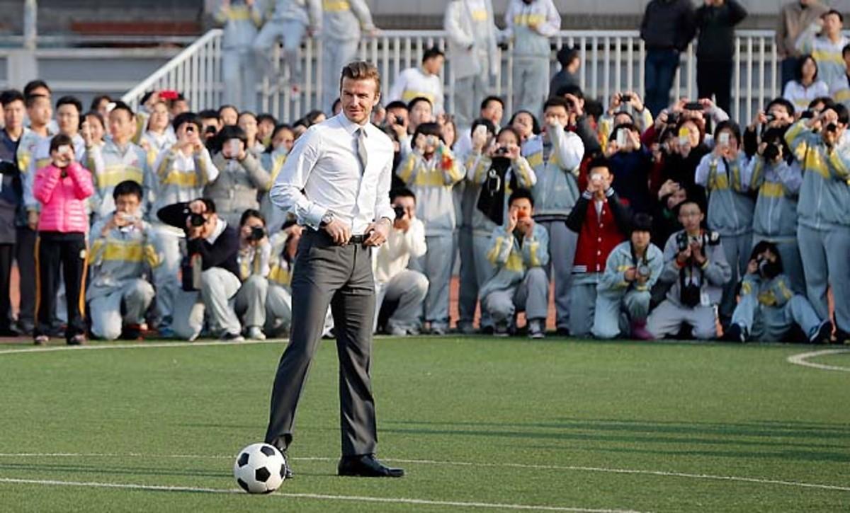 David Beckham kicks off his China visit at a middle school in Beijing.