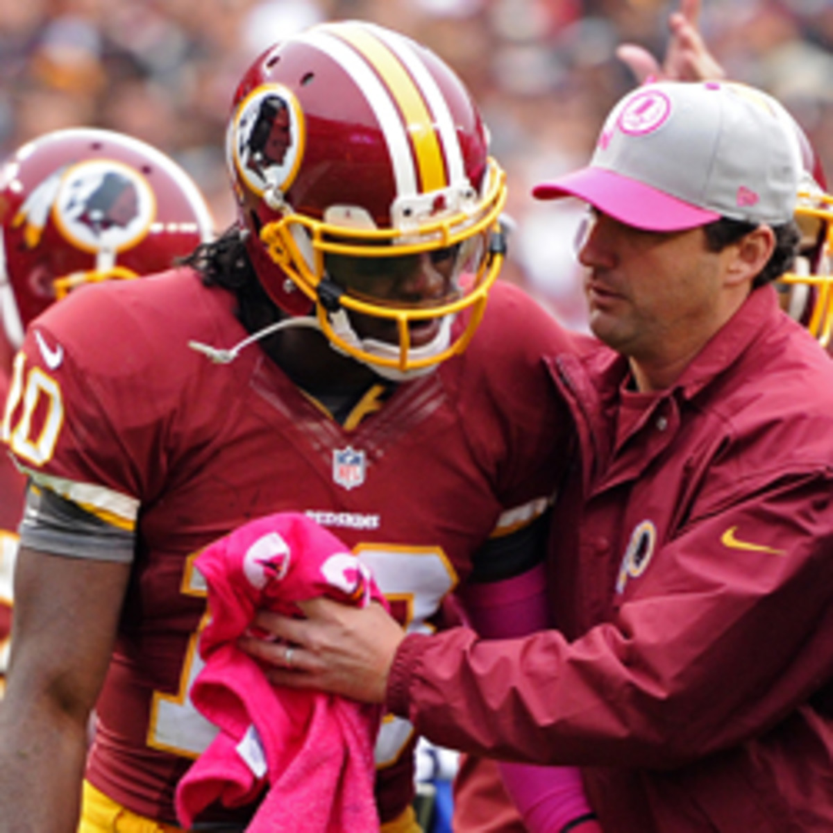 Robert Griffin III has practiced twice after suffering a concussion. (Patrick Smith/Getty Images)