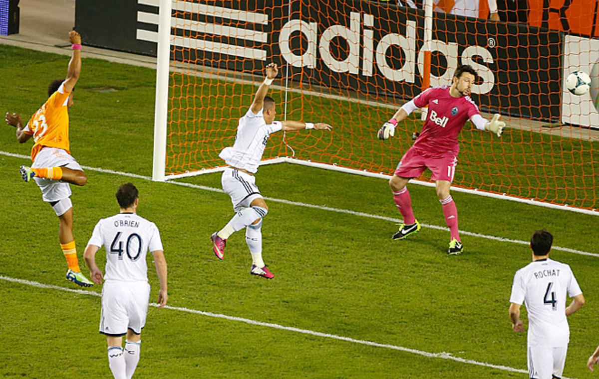 Giles Barnes heads in the tying goal for the Houston Dynamo against the Vancouver Whitecaps.