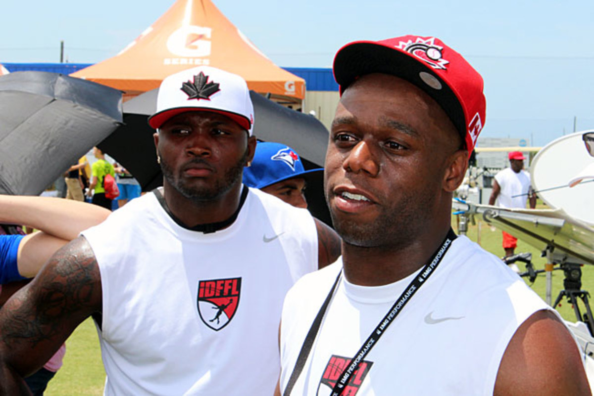 IDFFL coaches Anthony Cannon (left) and Jordan Younger help Canadian players attract recruiting buzz.