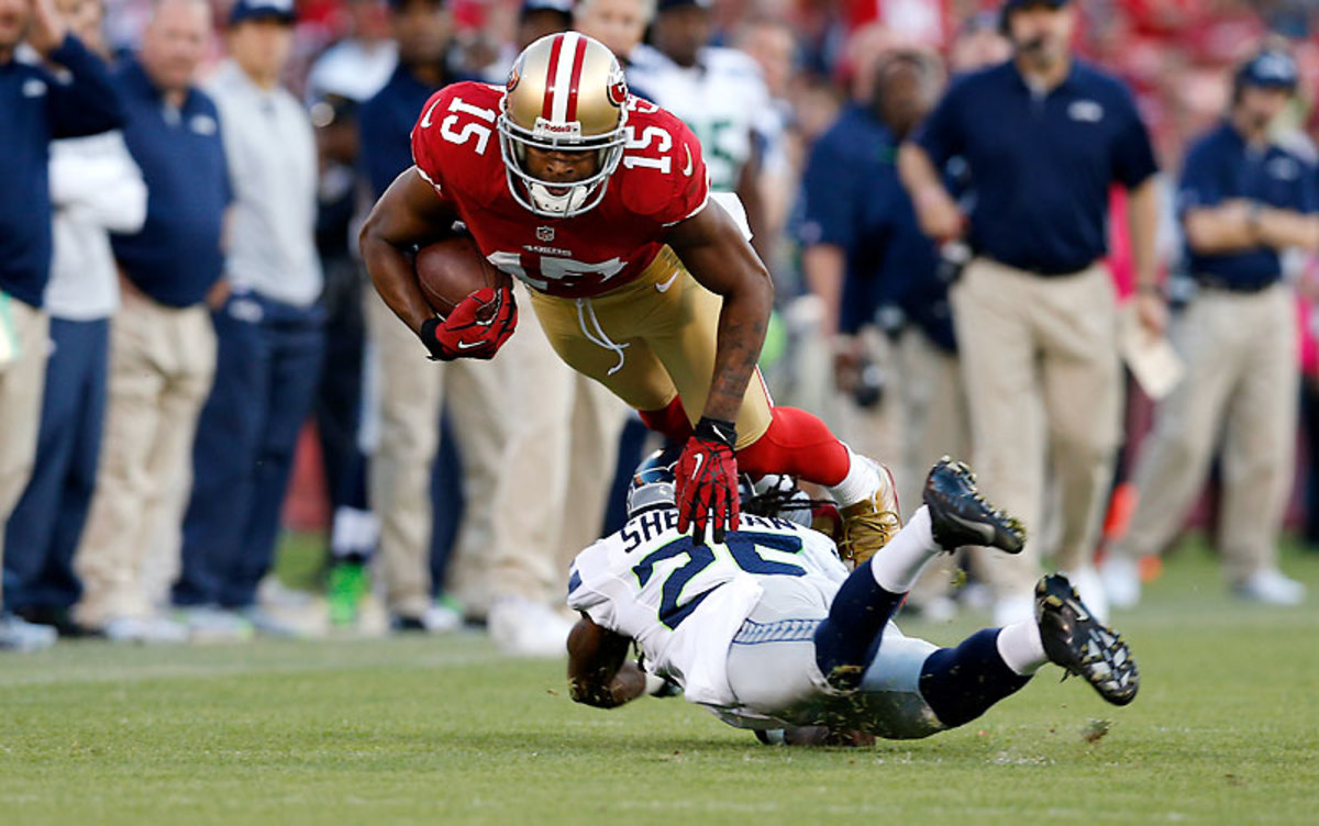Going low makes the tackler vulnerable to a head shot from the ball-carrier's churning knees. (Ric Tapia/Icon SMI)