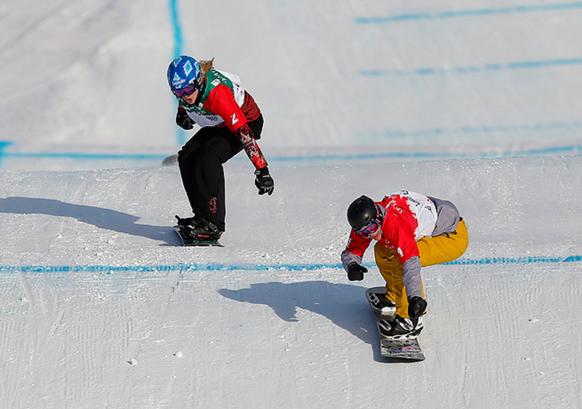 Lindsey Jacobellis (right) crossed the finish line ahead of Dominique Maltais of Canada.