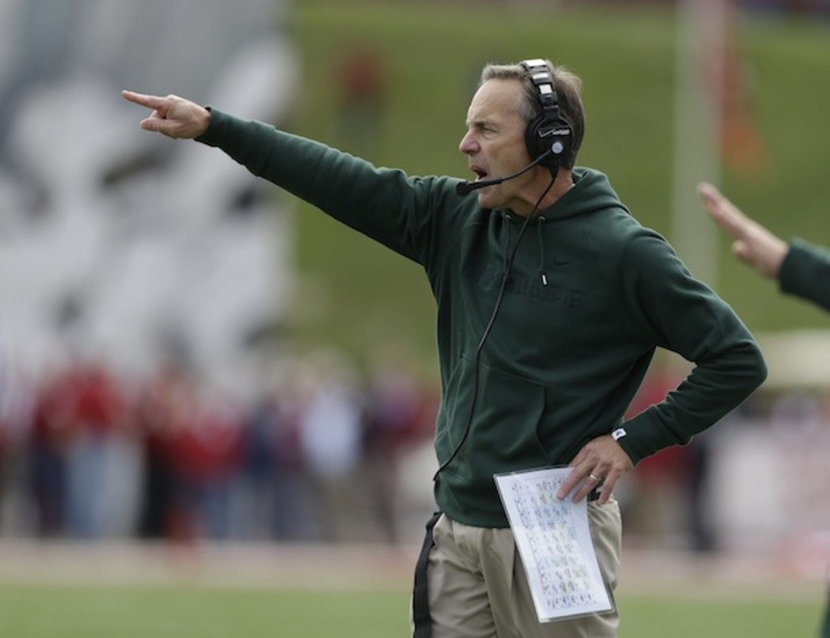 Mark Dantonio bids you a meticulously calibrated welcome to Spartan Stadium. (AP)