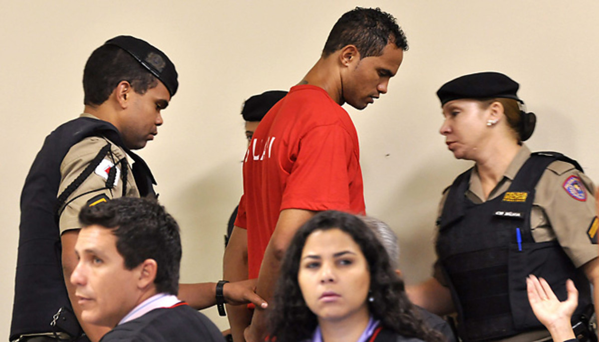 Former Flamingo goalkeeper Bruno is escorted by guards after being handed a 22-year prison sentence.
