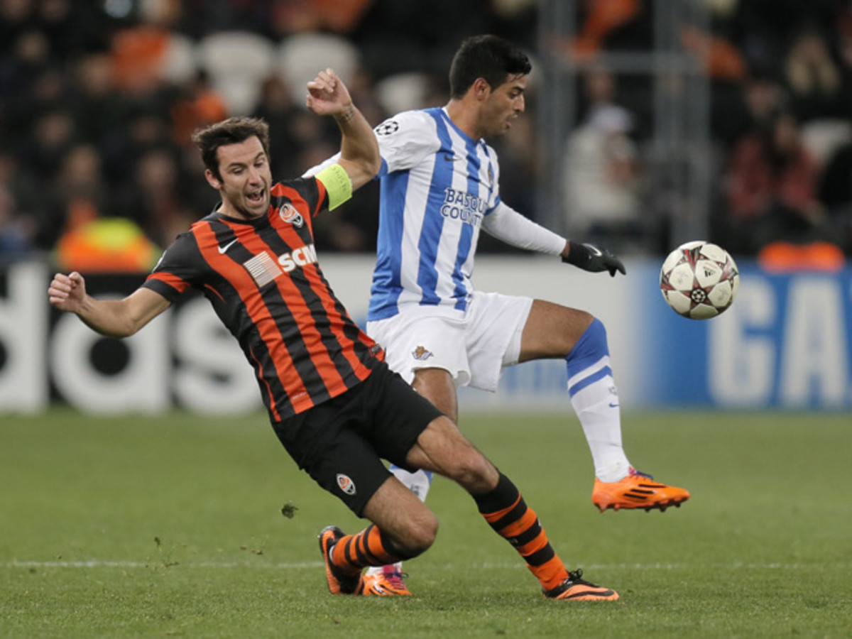Real Sociedad and Mexican forward Carlos Vela, right, challenges Shakhtar Donetsk's Darijo Srna for the ball in the Spanish club's 4-0 loss to the Ukranian power.