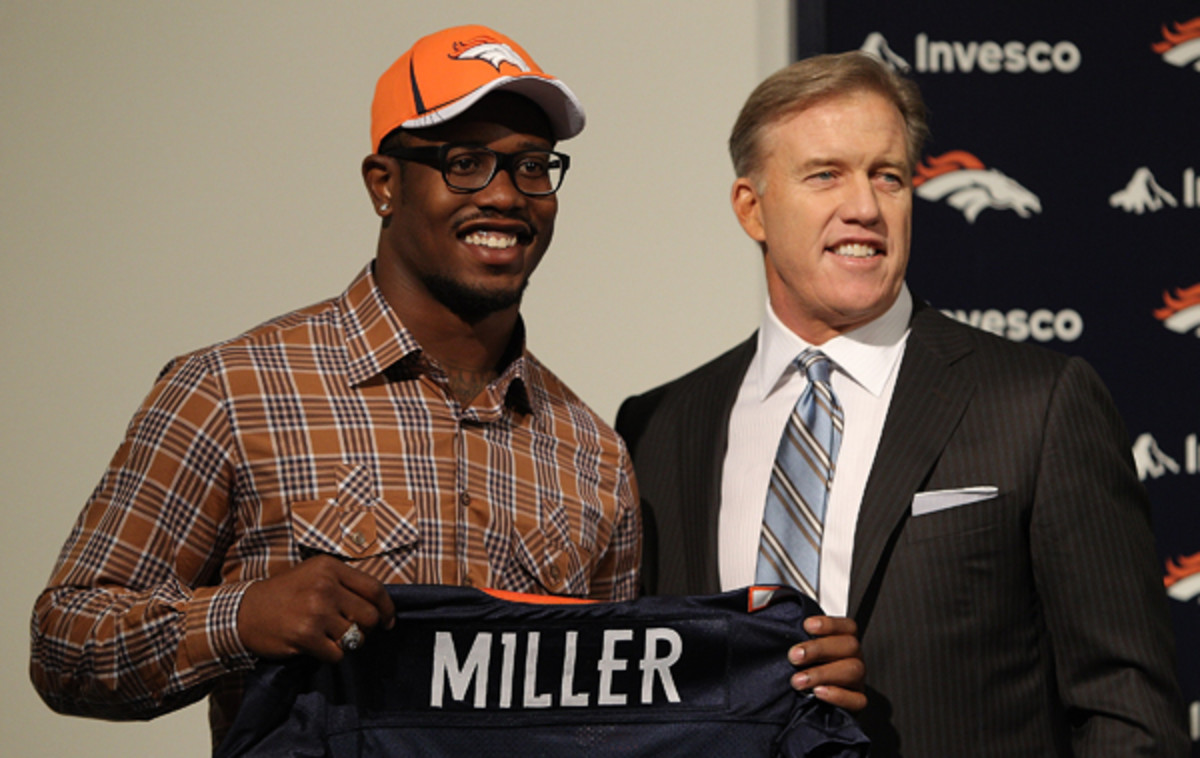 Von Miller and John Elway in happier times, when Miller was drafted in 2011. (Justin Edmonds/Getty Images)