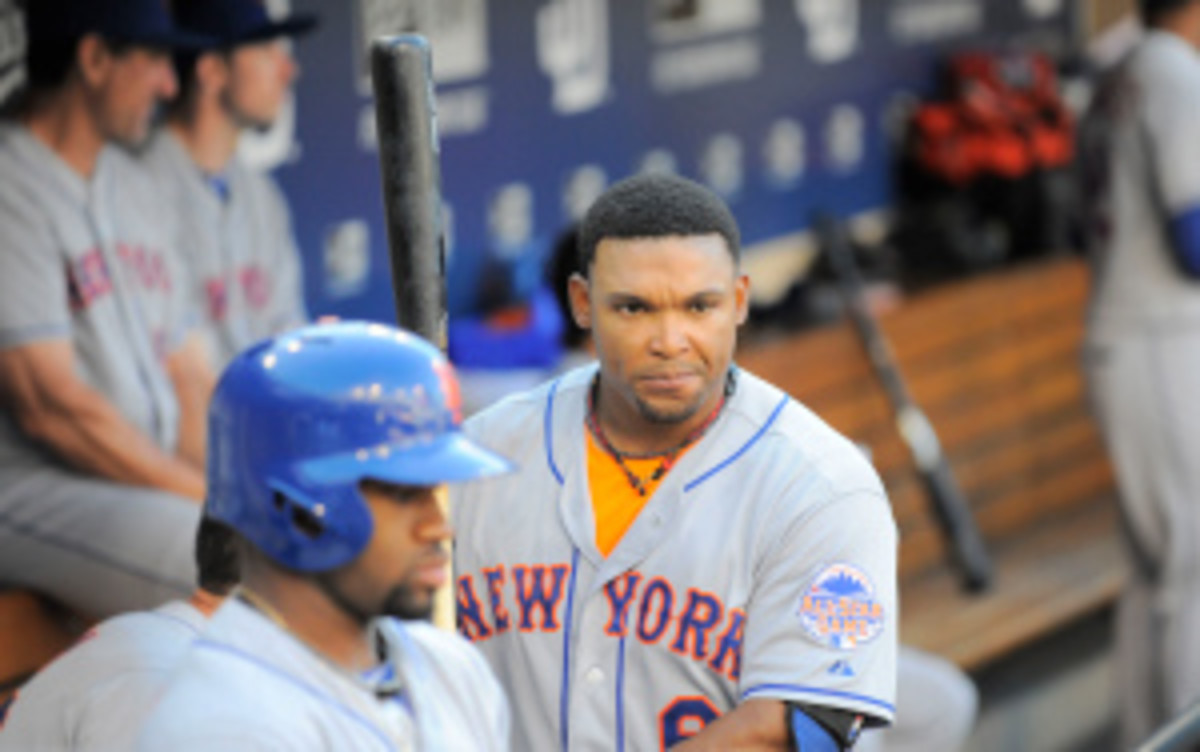 Mets outfielder Marlon Byrd and catcher John Buck were traded to the Pirates on Tuesday. (Denis Poroy/Getty Images)