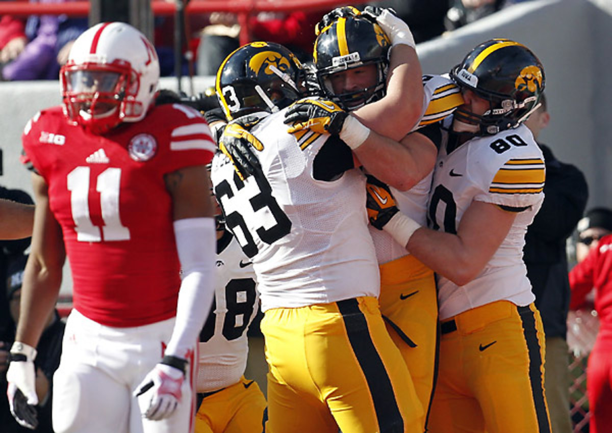 Iowa topped Nebraska 38-17 for its third straight win to close out the regular season.