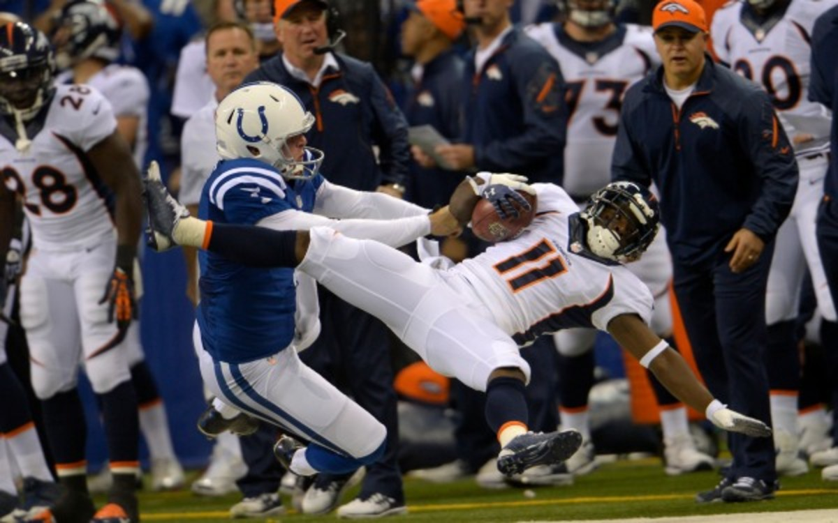 Colts punter Pat McAfee was not fined for this big hit on Trindon Holliday. ( Joe Amon/Denver Post/Getty Images)