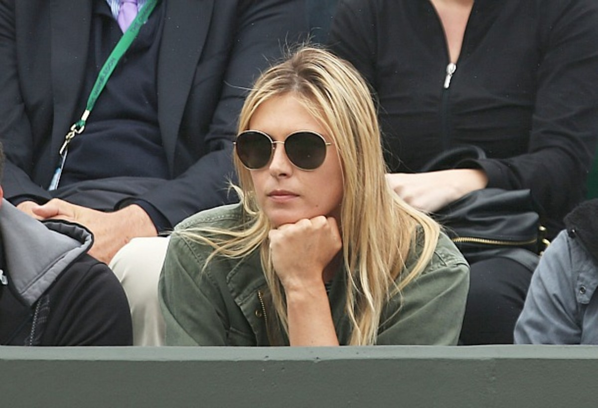 Maria Sharapova watches Grigor Dimitrov on Day 5 of Wimbledon. (Getty Images)