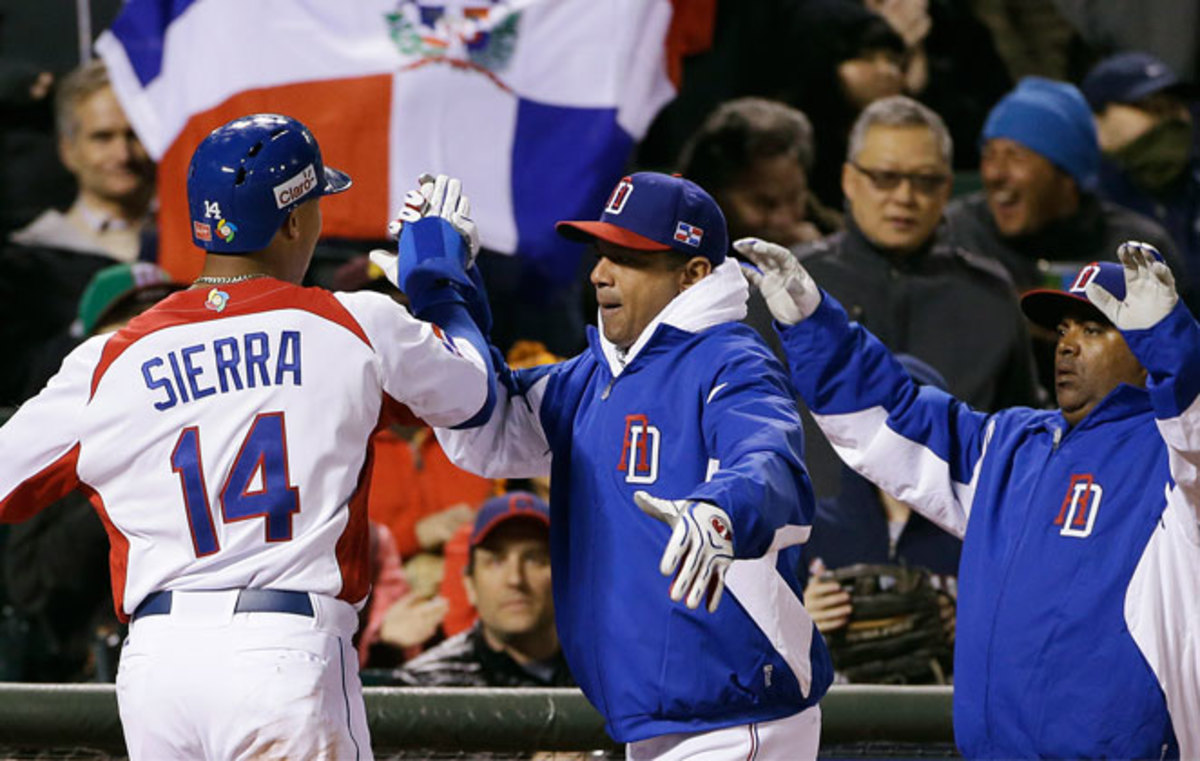 Moises Sierra (left) drove in the first run in a fifth-inning rally for the Dominican Republic.