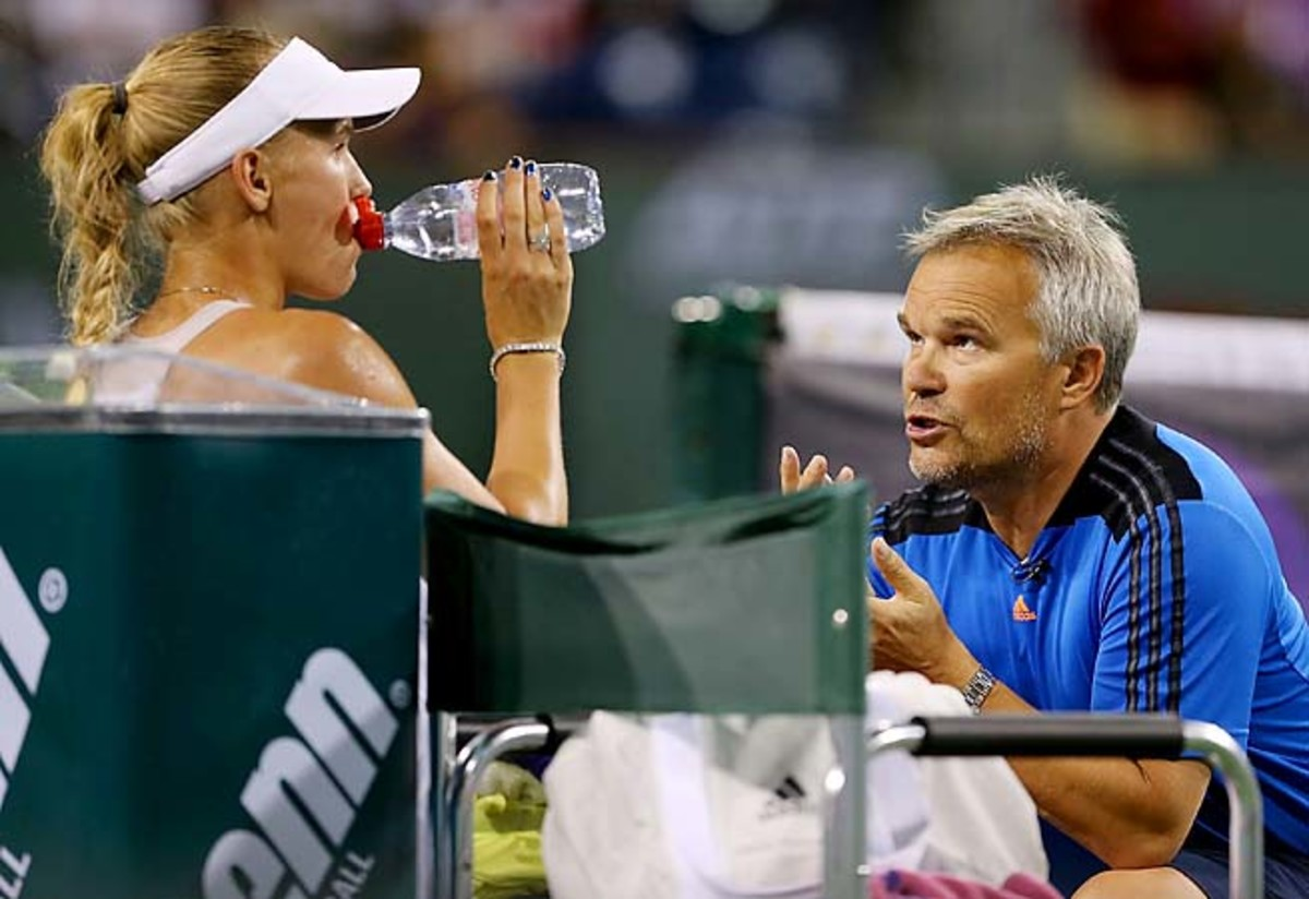 Caroline Wozniacki receives on-court coaching from her father, Piotr, at Indian Wells in March.